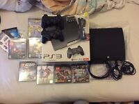 Boxed Playstation 3 (PS3) Slim 120GB with two dual shock controllers and games
