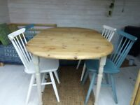 Farmhouse pine table with four Ercol chairs