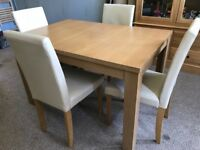 Extending oak effect dining table with 4 chairs