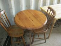 MODERN SOLID PINE SMALL ROUND TABLE & 2 PINE CHAIRS. VIEWING/DELIVERY AVAILABLE