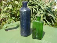 2 vintage glass bottles , one green and one blue marked Poison