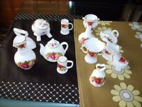 Collection of 12 china collectables in a basket