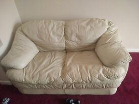 Two seat cream leather sofa