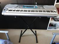 Casio WK3000 76 key electronic keyboard with stand