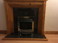 Electric fire and a wooden fire surround