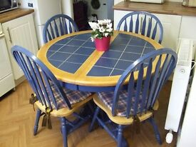 table & 4 chairs country style solidly made in great condition extends to seat 6-8