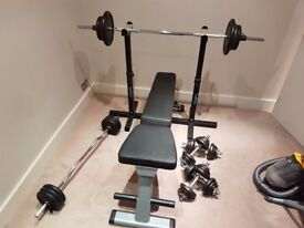 BodySolid GFID225 Folding Multi-Bench with Weights, Bars, Dumbbells and Spotter Racks