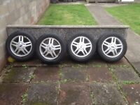 Ford alloy wheels with tyres.
