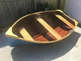 "Brand new. 7'6"" wooden dinghy , built professionally using marine ply and epoxy resin."