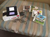 Nintendo DS with box and 4 games