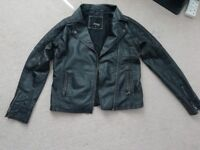 Ladies Quality black leather jacket. Size 12, worn but good condition.