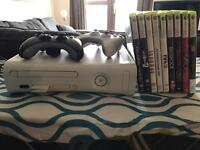 Xbox 360 with 2 pads and 9 games