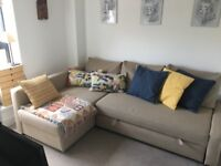 Beautiful Sofa bed, with chaise longe and storage, New.