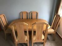 Extendable dinning table+6 chairs.