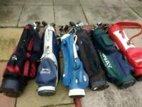 100 golf clubs& 6 golf bags.