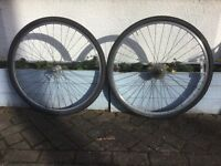 Pair hybrid 700C wheels with 7-speed cassette and tyres
