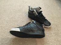 Brand new black Adidas high tops size 9 cost £95.