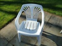 Set of 4 white plastic garden chairs. Stackable for storage.