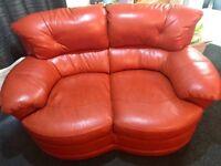 Sunburst orange leather sofas x 2