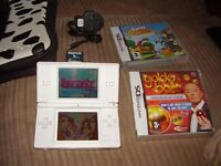 NINTENDO DS LITE WITH CHARGER AND GAMES AND CASE