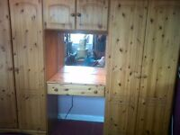 wall unit , 2 wardrobes and cupboard above a vanity unit, 7 chest of draws and bedside cabinet