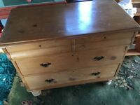 A victorian waxed pine chest of drawers