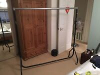 Large free standing clothes hanging rail on wheels