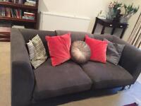 Two grey mid century sofas linen
