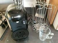 Bosch Tassimo machine with 6x glass mugs and pod stand. All been used but in excellent condition