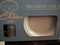 Never Used. Mint condition. Breakfast set consisting of 4 Bowls, 4 side plates and 4 mugs.