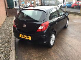 Vauxhall Corsa SE 1.4 petrol. 5 door. 2011 black. 12 months MOT and warranty included