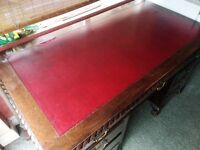 Red leather top, dark wood writing desk with 9 drawers