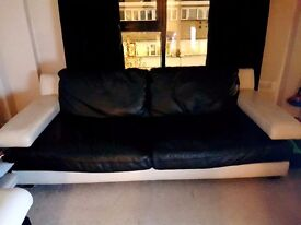 Black and cream leather sofa
