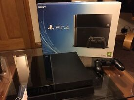 PlayStation 4 boxed with controller