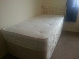 Cream single bed with matress drawers and headboard