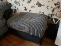 Grey Chenille fabric and black leather corner sofa with matching footstool