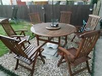 outdoor round table and 6 chairs