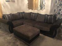 Corner sofa + footstall grey and black