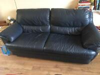 Deep blue leather sofa