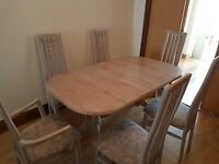 limed oak Extendable Dining Table with 2 arm chairs 4 normal chairs Good Condition