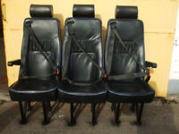 set of three leather seats. with seat belts .black with blue piping