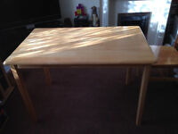 Lovely solid light wood dinning table and four chairs for sale
