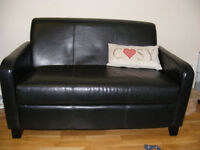 Brown faux leather two seater and chair