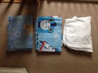 Two single bed duvet covers and pillowcases and white fitted bed sheet