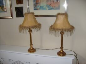 Reduced by 40% : A pair of beautiful gold coloured lamps.