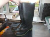 Men's size 10 black Wellington Boots, heavy and sturdy.
