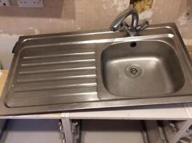 Kitchen sink with taps