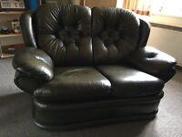 Dark green leather sofa
