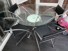 Glass dining tavle and chairs