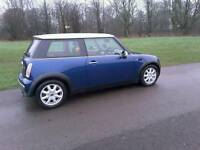 MINI COOPER 2003, ONE PREVIOUS OWNER ,ONLY 75000 MILES. INDI BLUE, TWO TONE LEATHER INTERIOR.